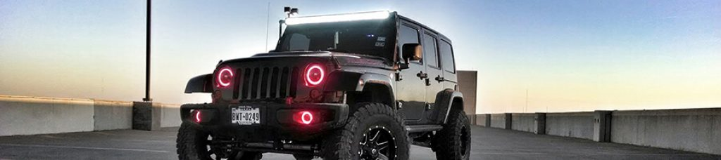 Jeep wrangle with red led halo lighting rings in headlights